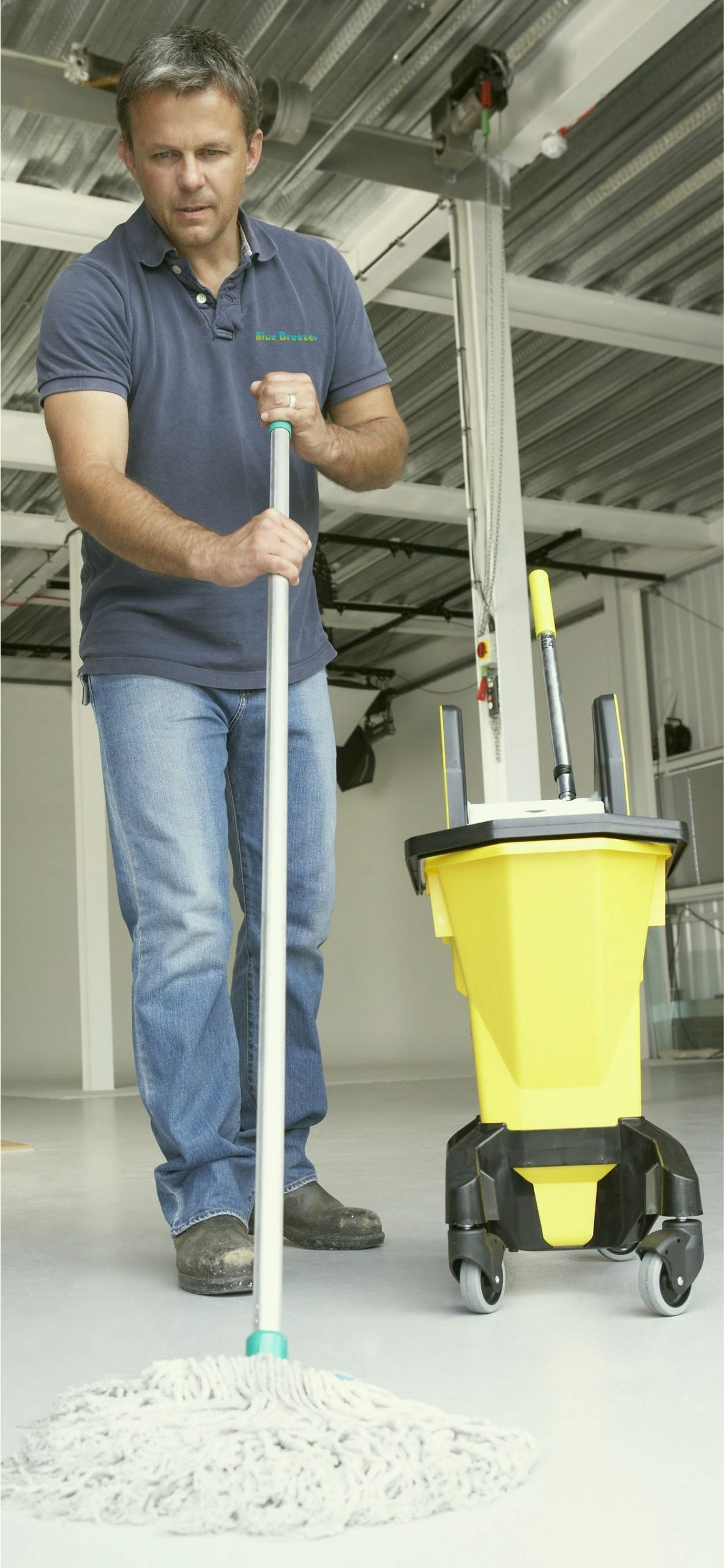 qulaity cleaning services Cardiff staff mopping floor