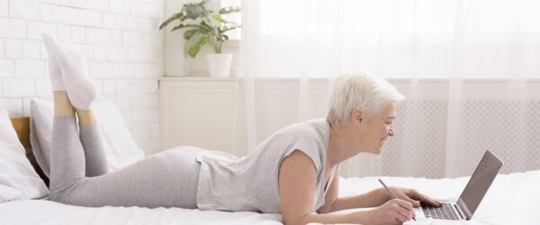 http://www.dreamstime.com/royalty-free-stock-photo-worldwide-connection-cheerful-senior-lady-chatting-laptop-online-lying-bed-panorama-cheerful-senior-lady-chatting-laptop-image162729115